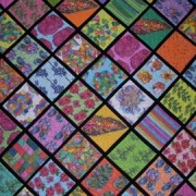 Part of a throw quilt made by my Grandma with Botanica Fabrics